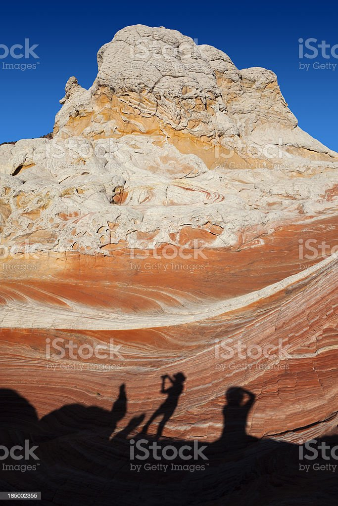 The shadow of tourists at rock in White Pocket royalty-free stock photo