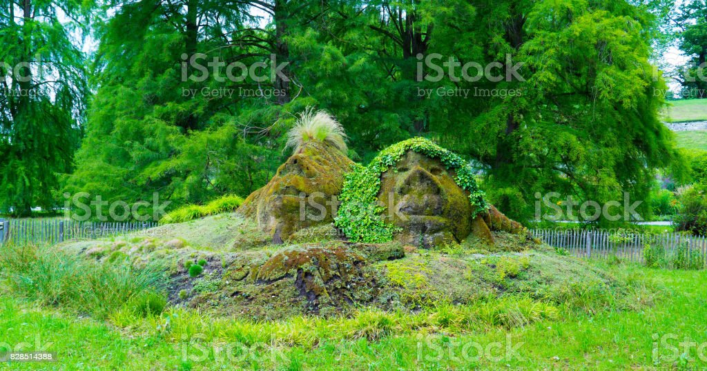 The shape of two faces in the grass on the island of Mainau in the center of Europe. stock photo