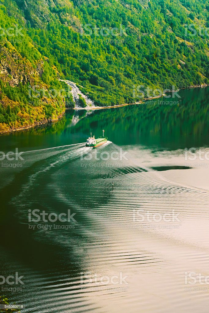 The ship floating in  water  narrowest fjord  Norway - Naeroyfjord stock photo