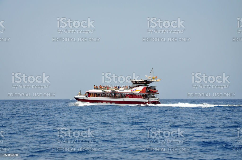 The ship with tourists in the ocean off the coast of Tenerife. stock photo