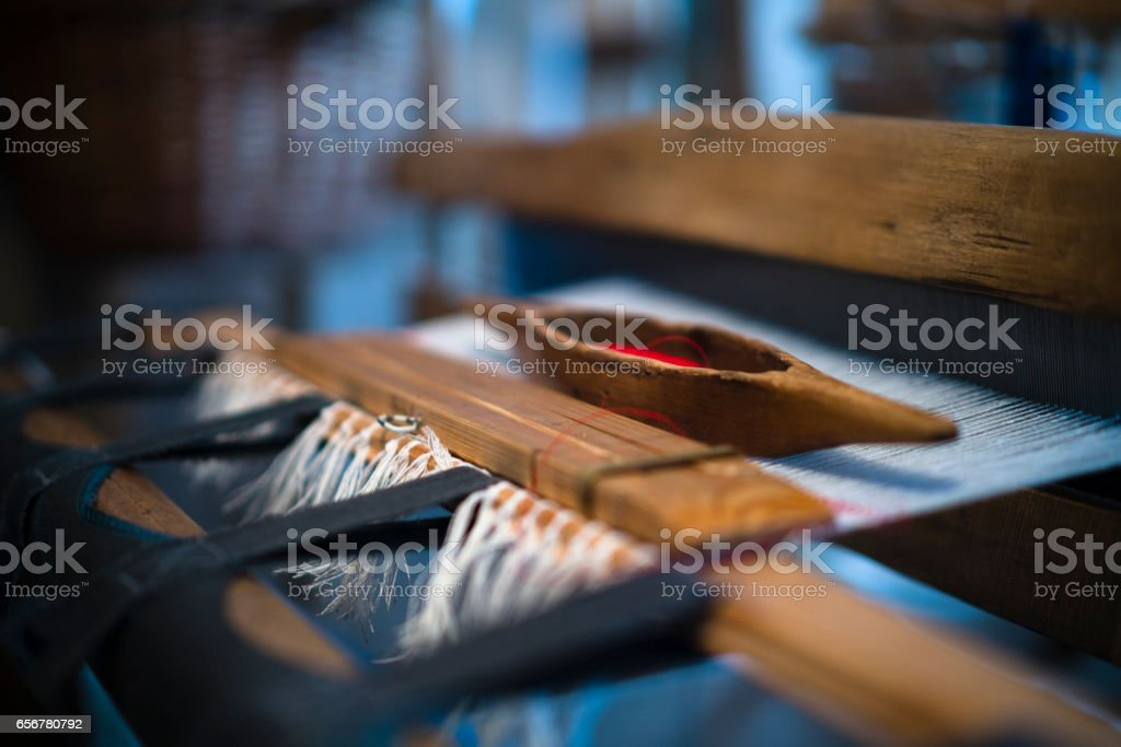 The shuttle on the antique loom stock photo