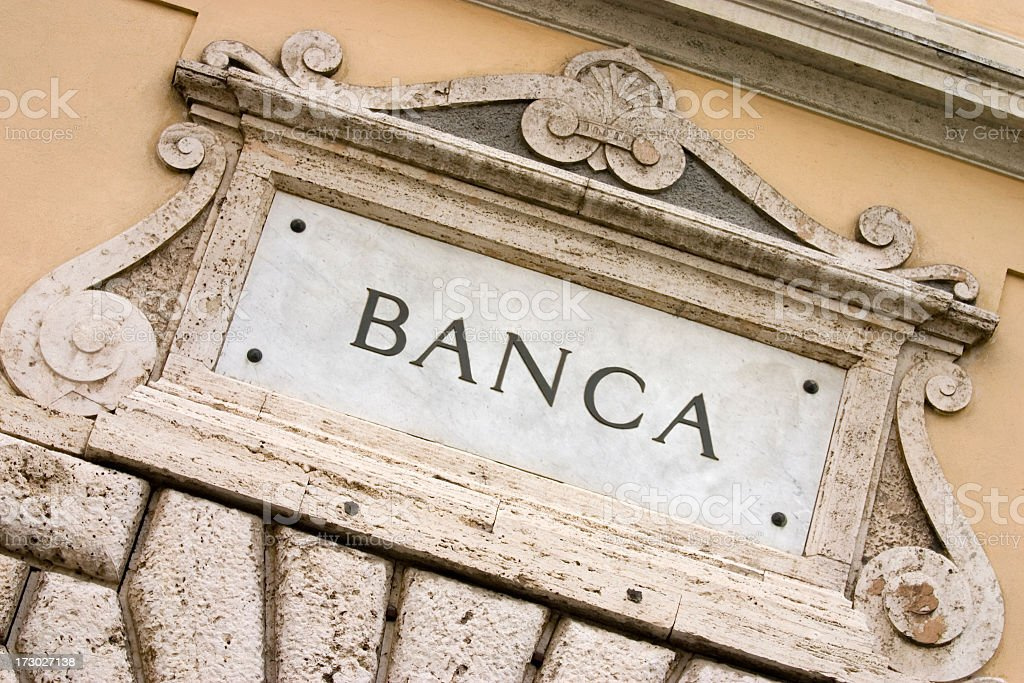 The signage of an Italian Bank etched in marble  stock photo