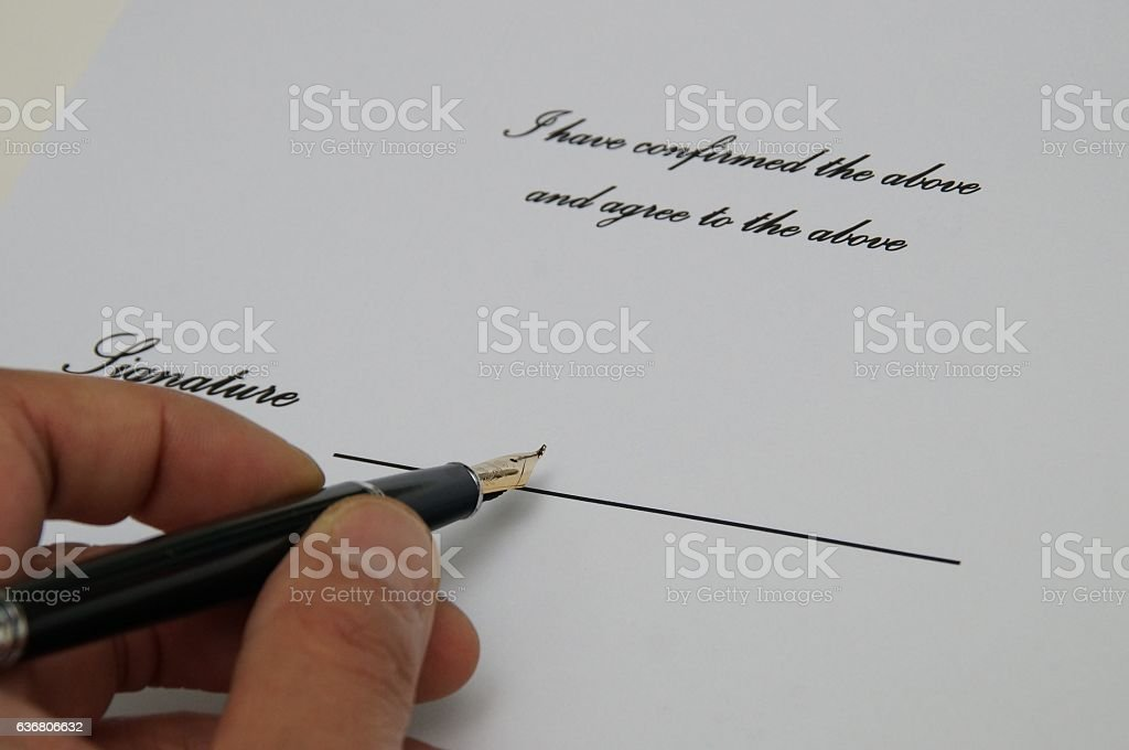 The signature of a document and hold pen hand