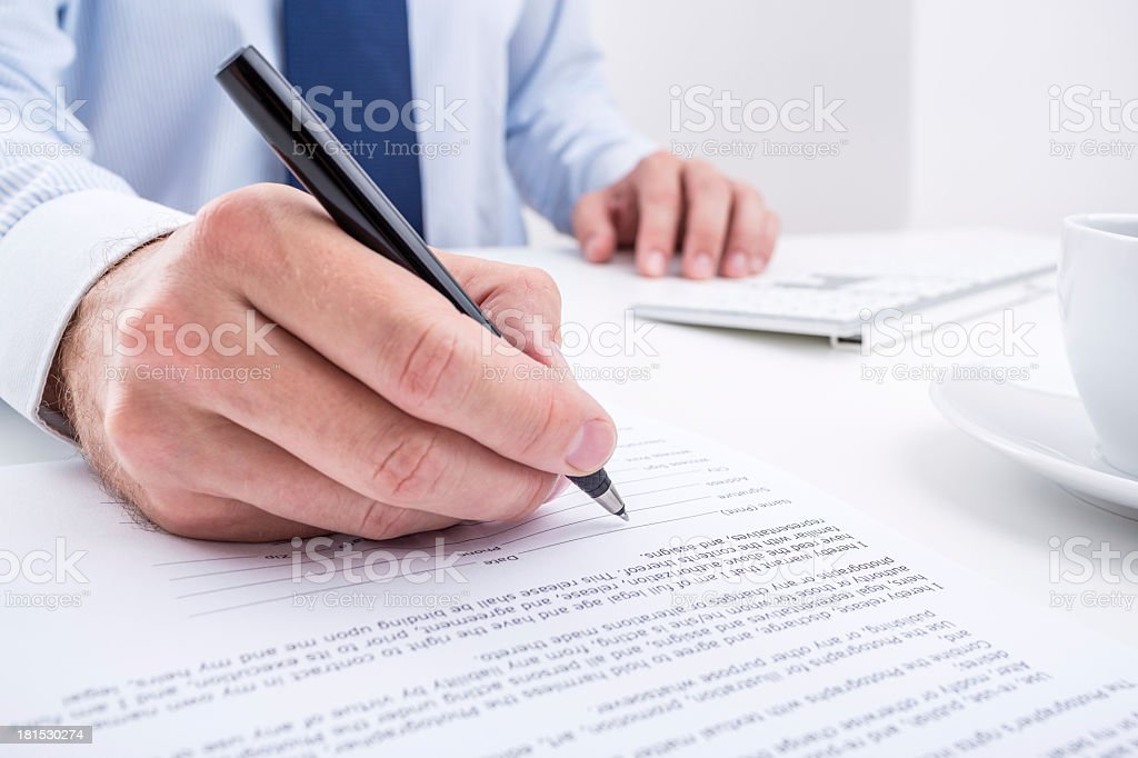The signing of an important business document stock photo