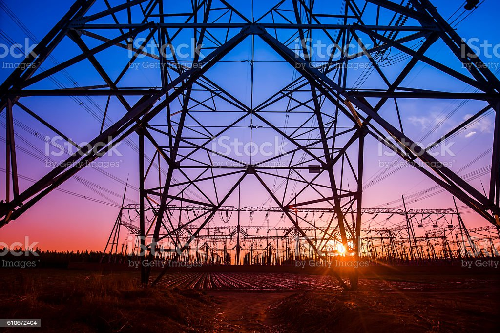 The silhouette of the evening electricity transmission pylon stock photo