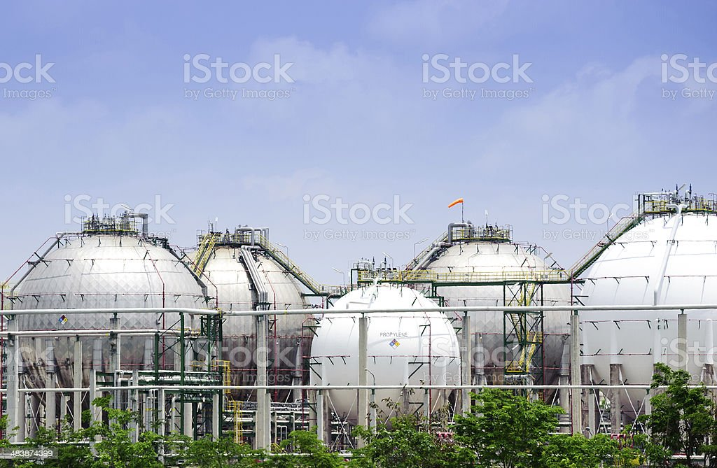 The silver and white huge storage natural gas tanks stock photo