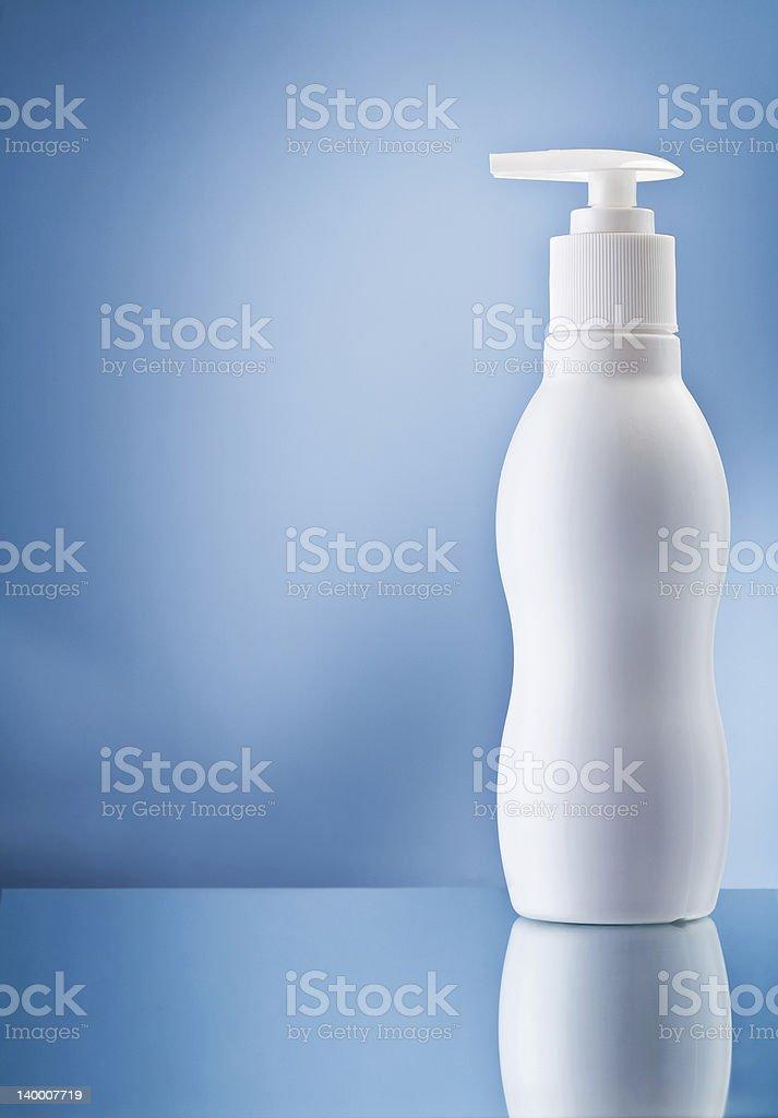 the single white bottle of cream on blue background royalty-free stock photo