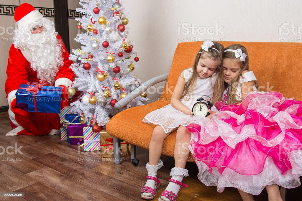 The sisters fell asleep while waiting for Santa Claus stock photo