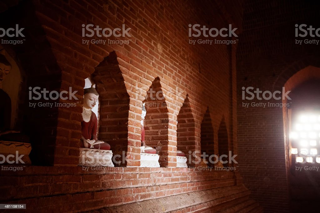 The sitting Buddha inside Church stock photo