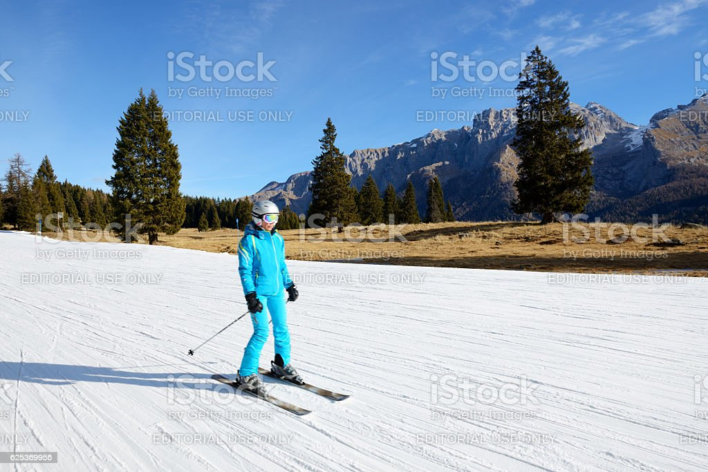 The ski slope and skier at Passo Groste ski area stock photo