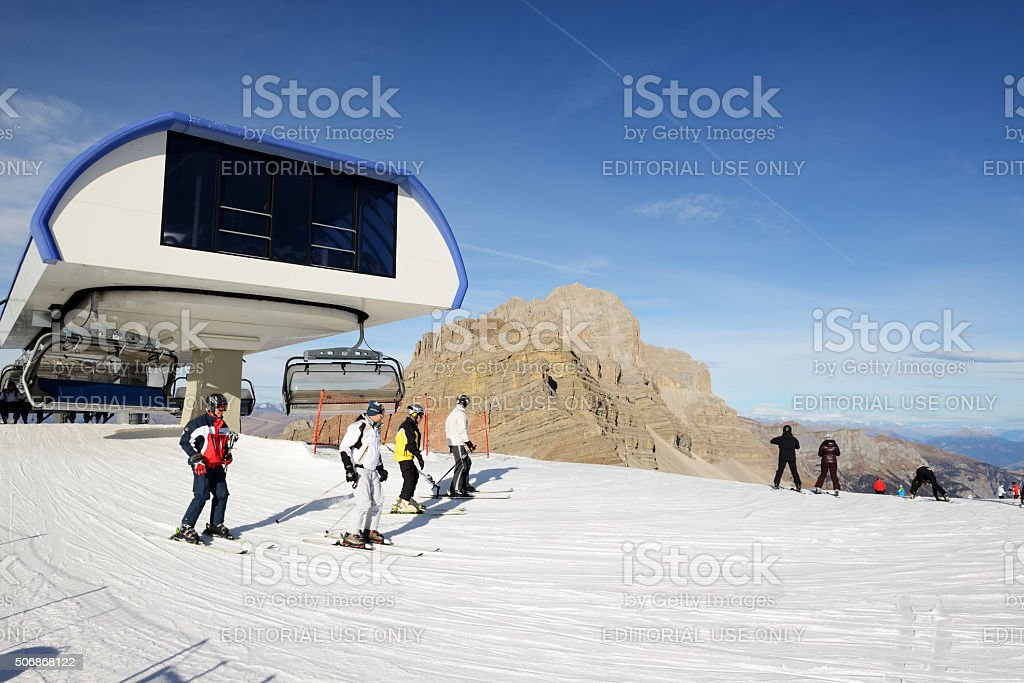 The ski slope and skiers at Passo Groste, Italy stock photo