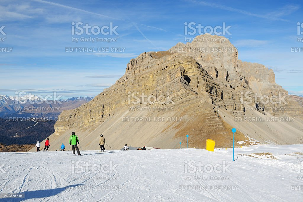 The ski slope and skiers at Passo Groste stock photo