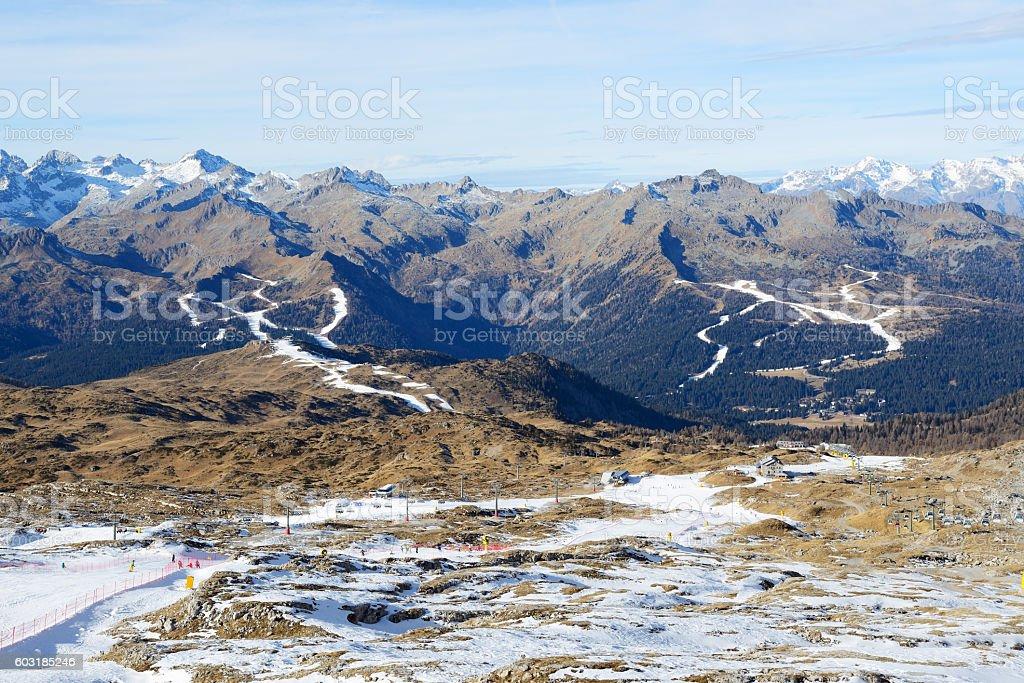 The ski slope with a view on Dolomiti mountains stock photo