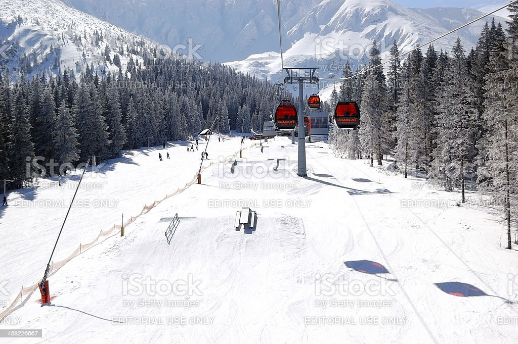 The skiers on slope and freeride park at Jasna stock photo
