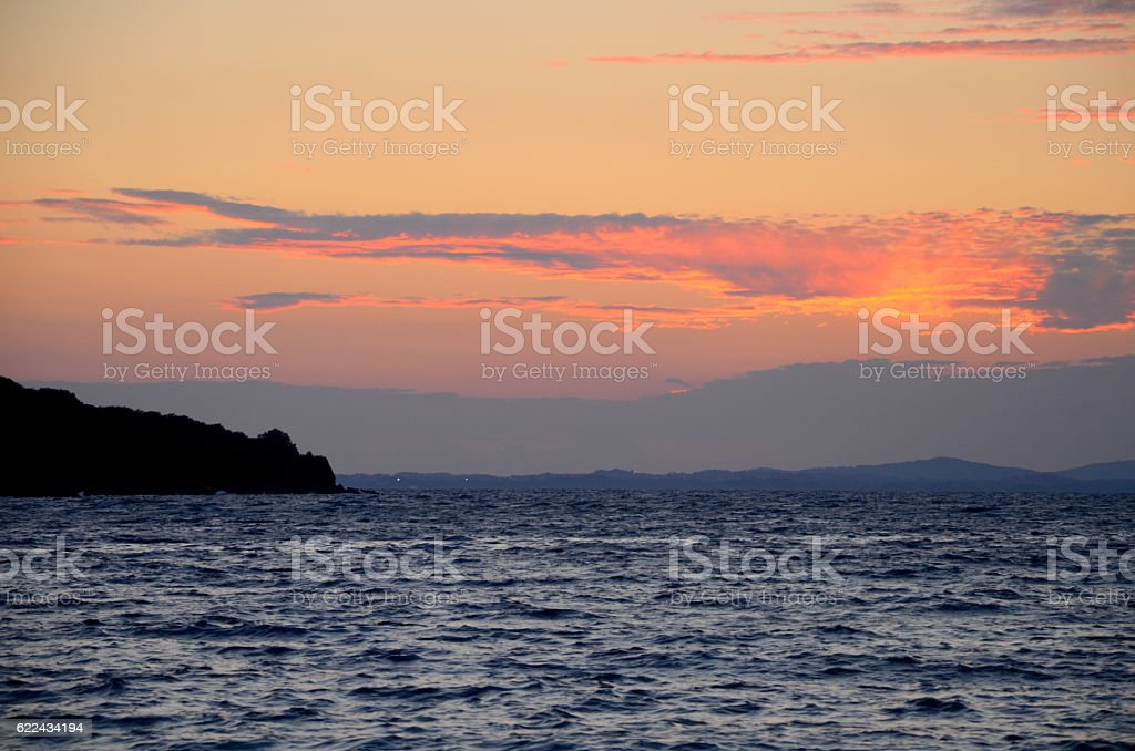 The sky at sunset on the sea stock photo