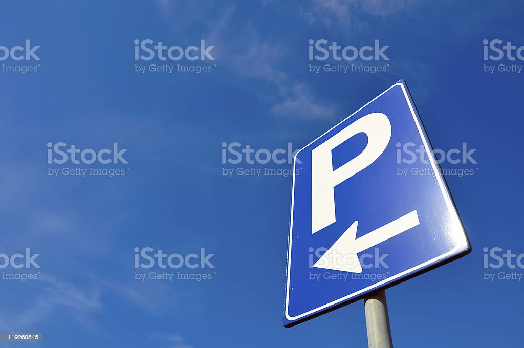 The sky is blue and there is a parking bay to the left royalty-free stock photo