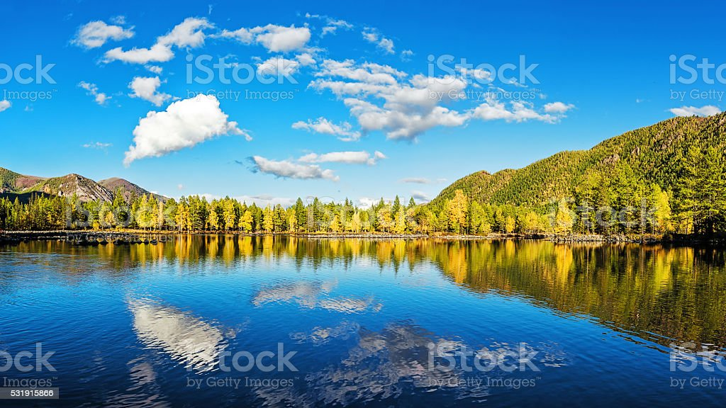 The sky is reflected in lake stock photo