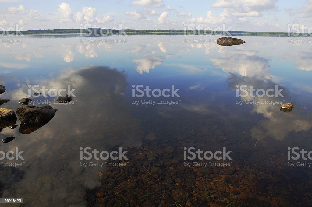 The sky is reflected in shallow backwater stock photo