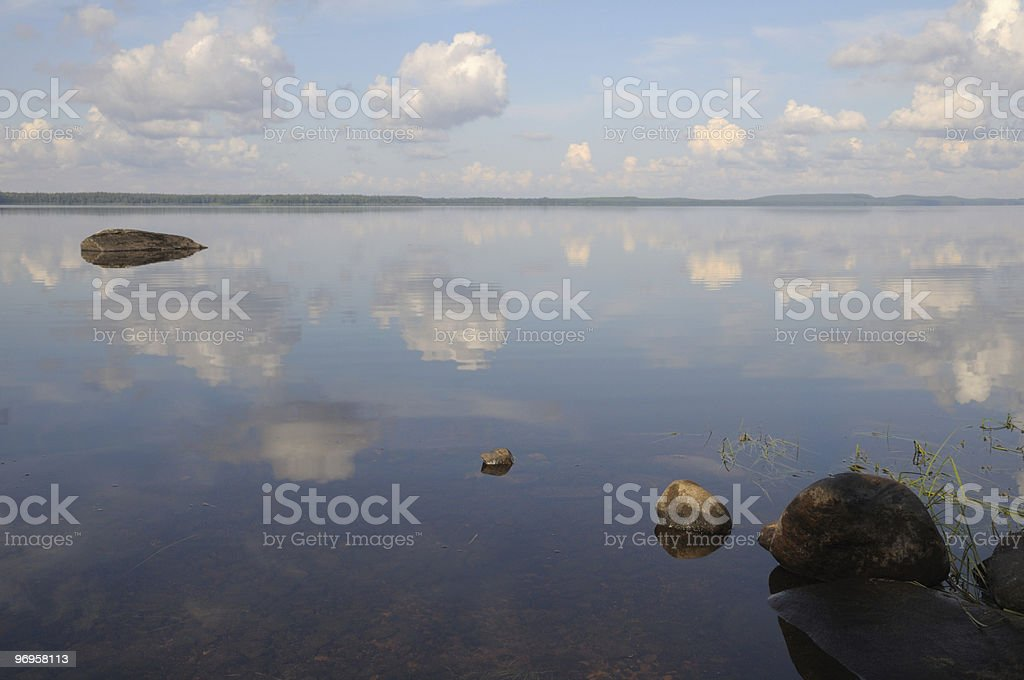 The sky is reflected in shallow backwater royalty-free stock photo