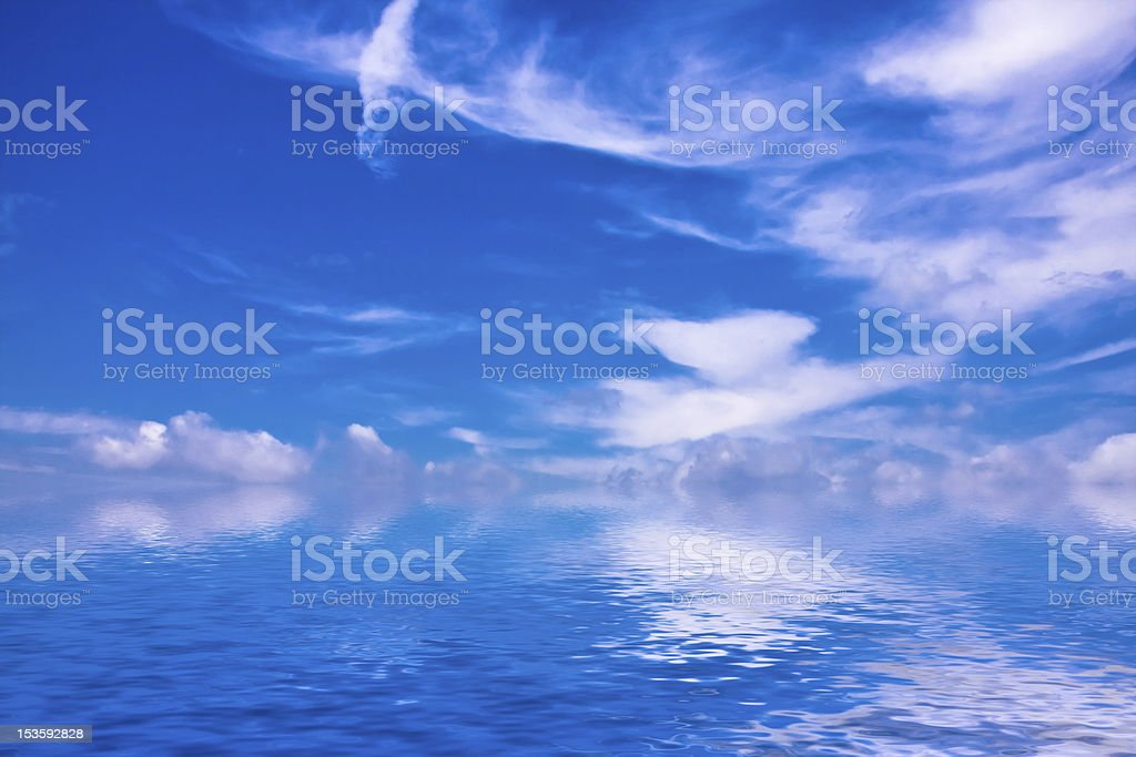 The sky reflected in a water stock photo