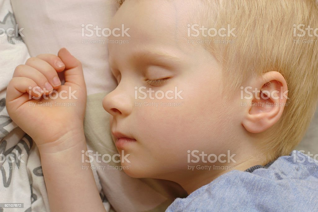 The sleeping boy. stock photo