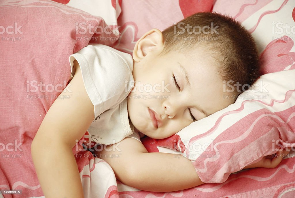 The sleeping boy stock photo