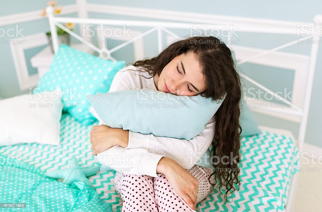The sleeping brunette in a pajamas. stock photo