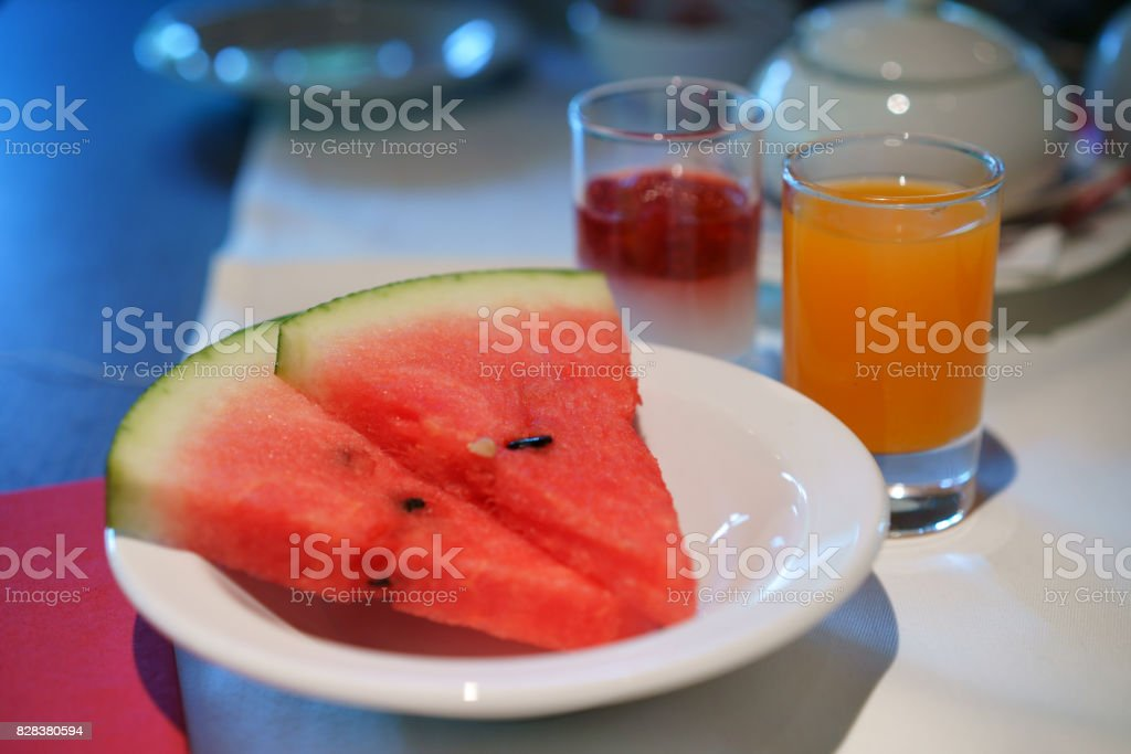 The slices of watermelon on the white plate stock photo