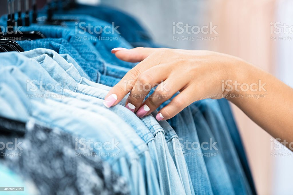 The sliding fingers on the clothes stock photo