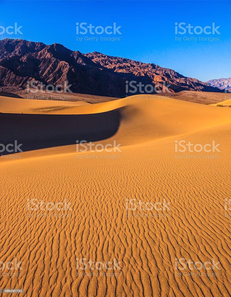 The slopes of sandy barkhans stock photo