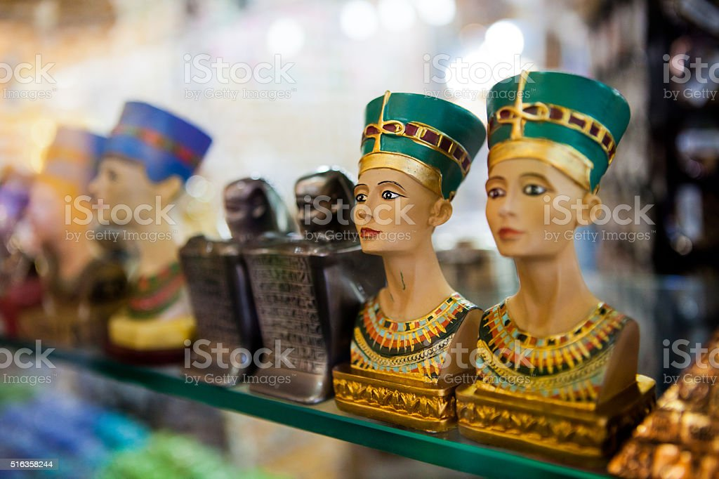 The small figurines Souvenirs on the shelf in Egypt stock photo