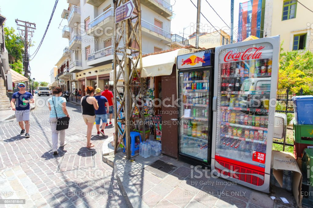Rethymnon, Island Crete, Greece, - June 23, 2016: The small market stall with street refrigerators with various cold drinks on the street of part Old Town in Rethymnon for tourists and local citizens stock photo