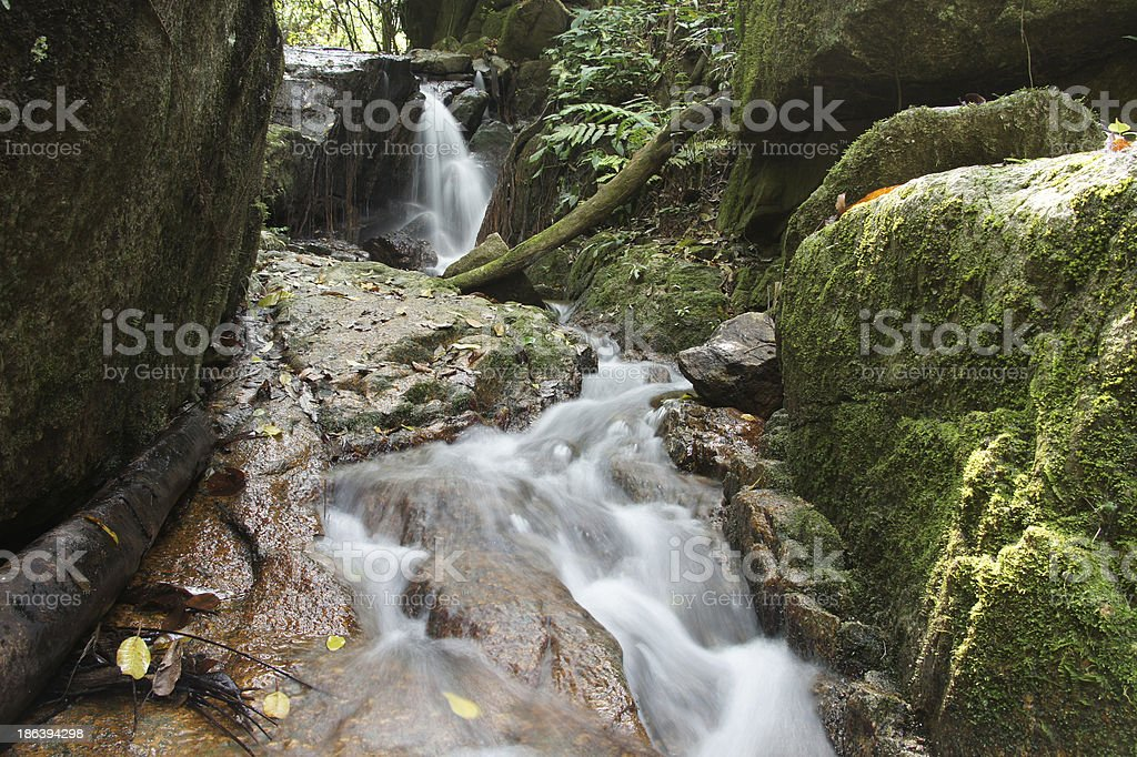 The small waterfall and rocks in forest, thailand royalty-free stock photo