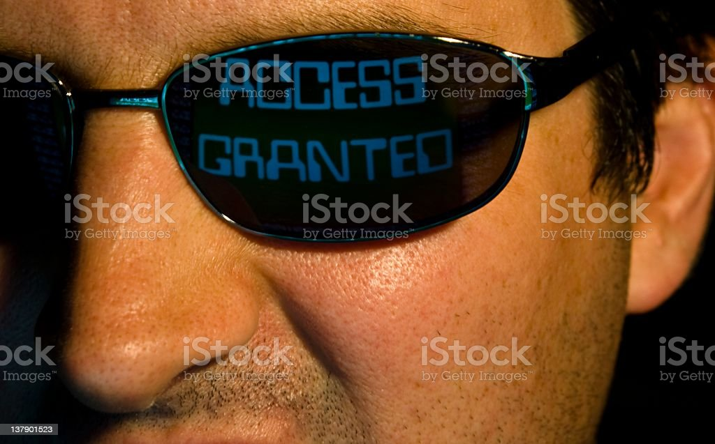 The smiling face of a computer hacker royalty-free stock photo