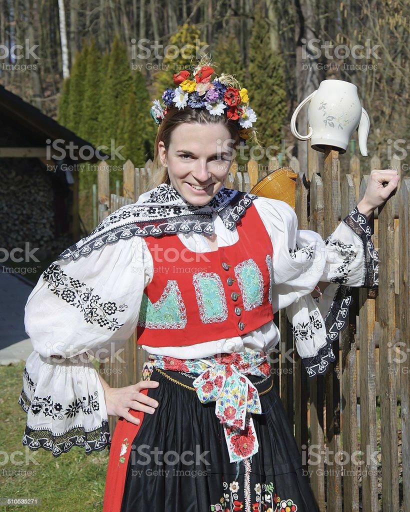 The smiling girl in folk costume stock photo