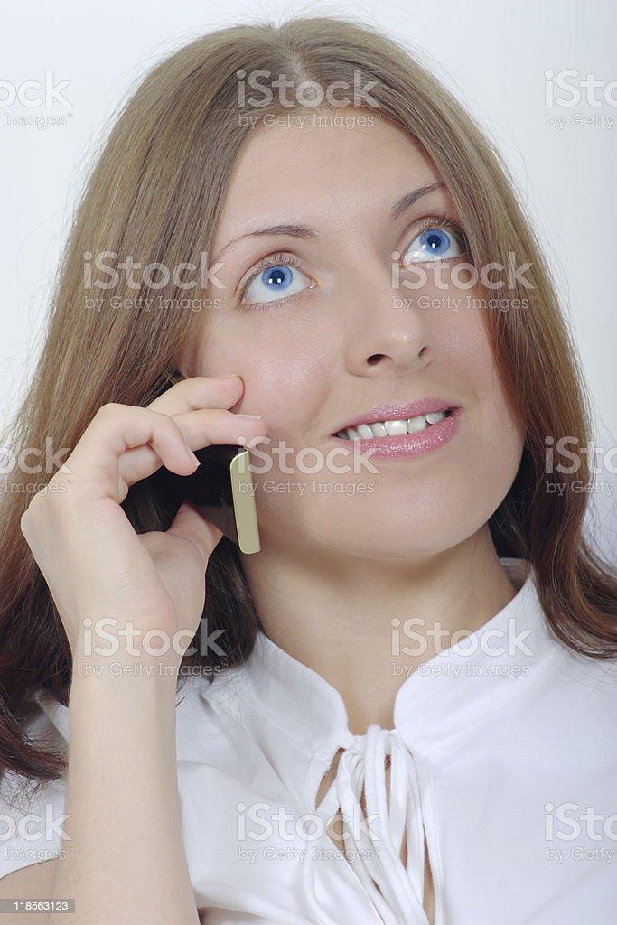 The uśmiechnięta Dziewczyna z telefonu komórkowego zbiór zdjęć royalty-free