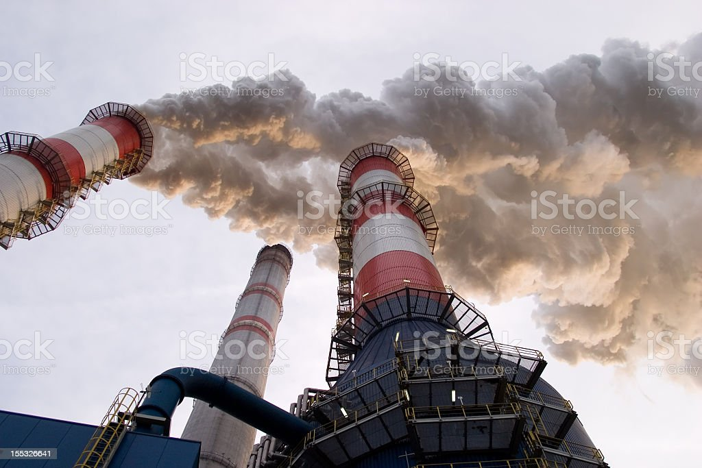The smoke coming out from thermal power plant stock photo