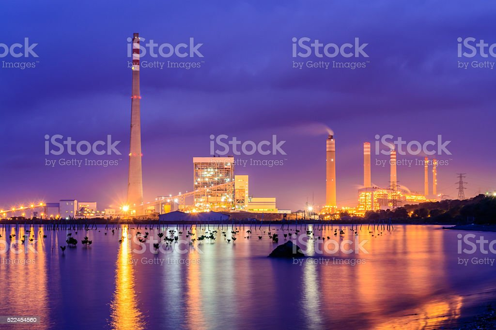 The smoke stacks of a power plant stock photo