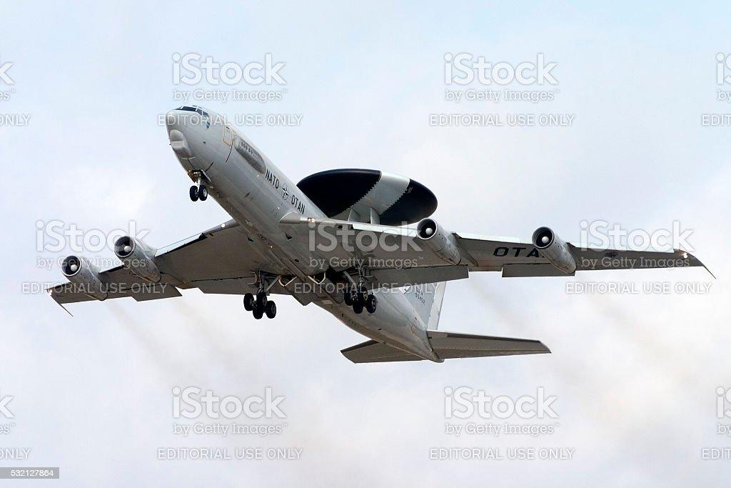 The smoking and noisy AWACS on take off stock photo