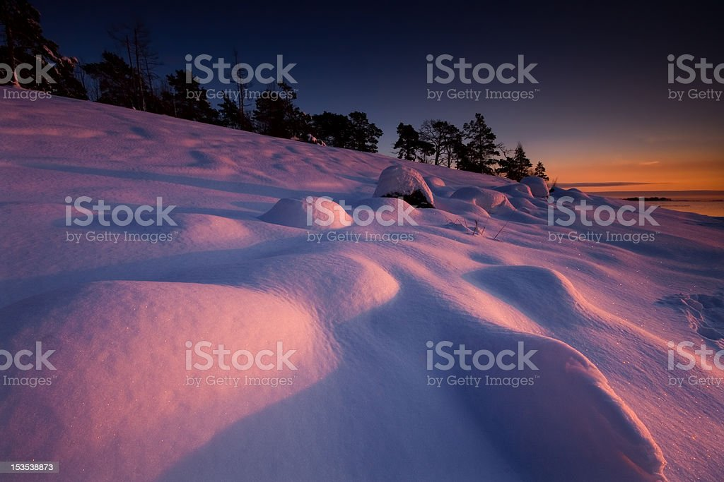 The snow mounds in late evening royalty-free stock photo