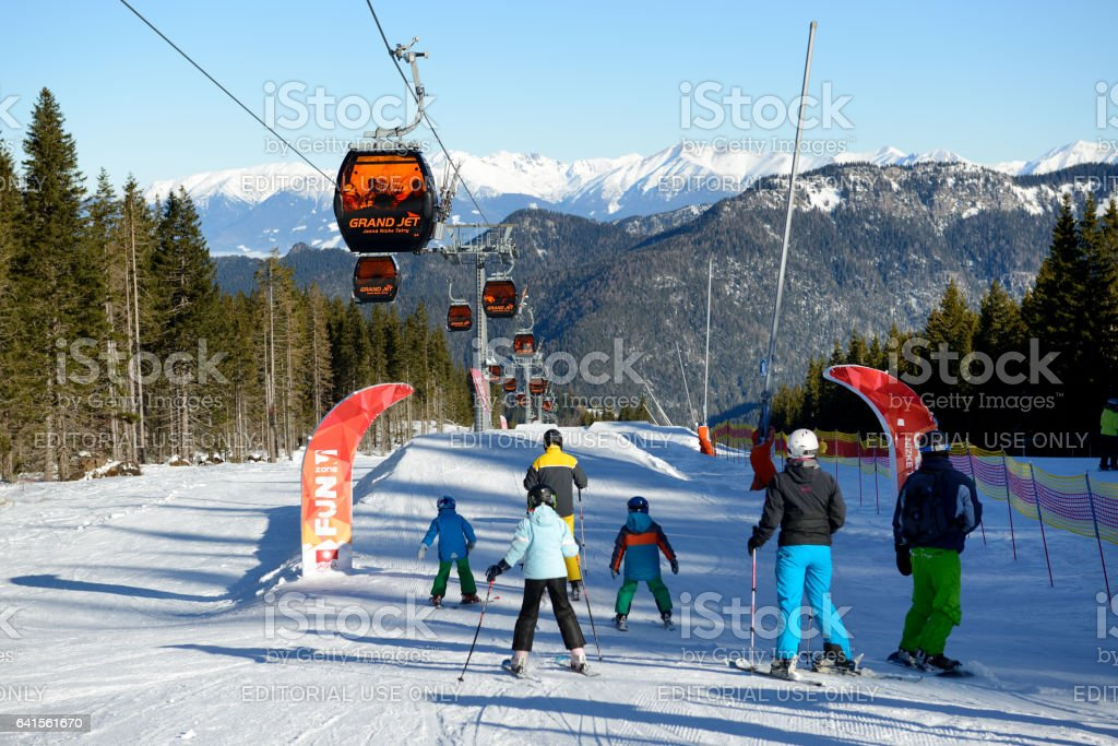 The snowpark, skiers and cableway in Jasna Low Tatras stock photo