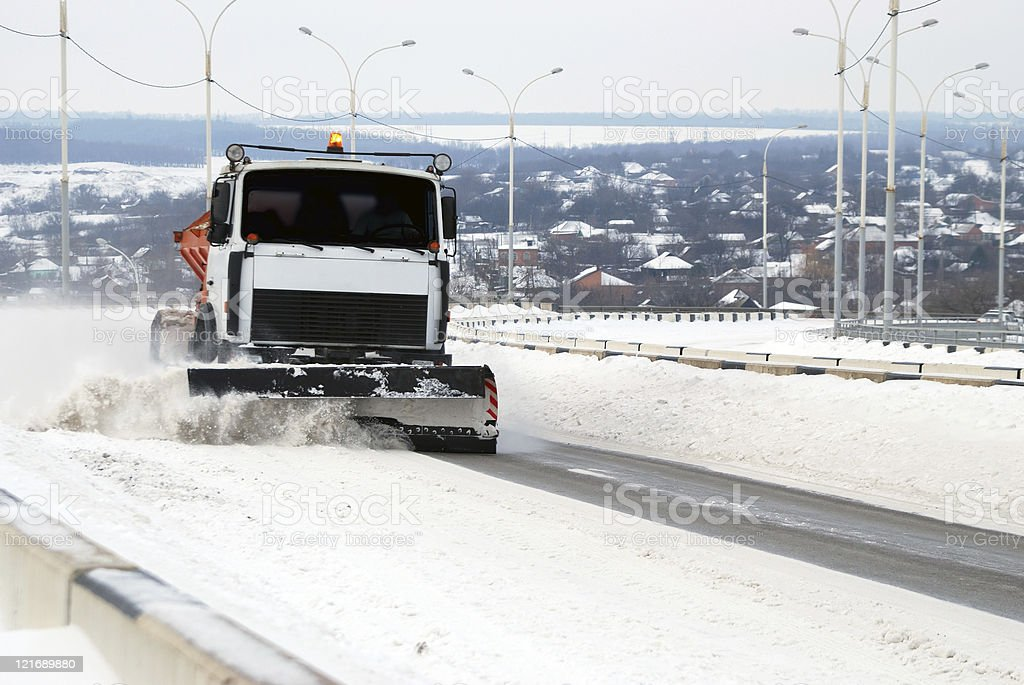 The snow-removing car cleans road after a strong snowfall royalty-free stock photo