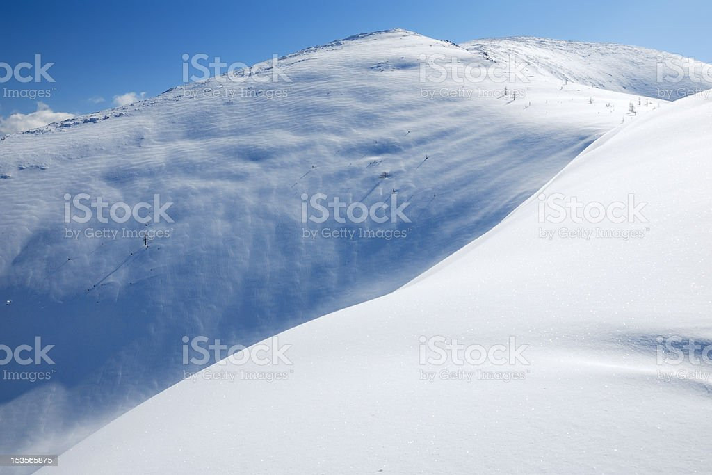 The snowslope in mountains royalty-free stock photo