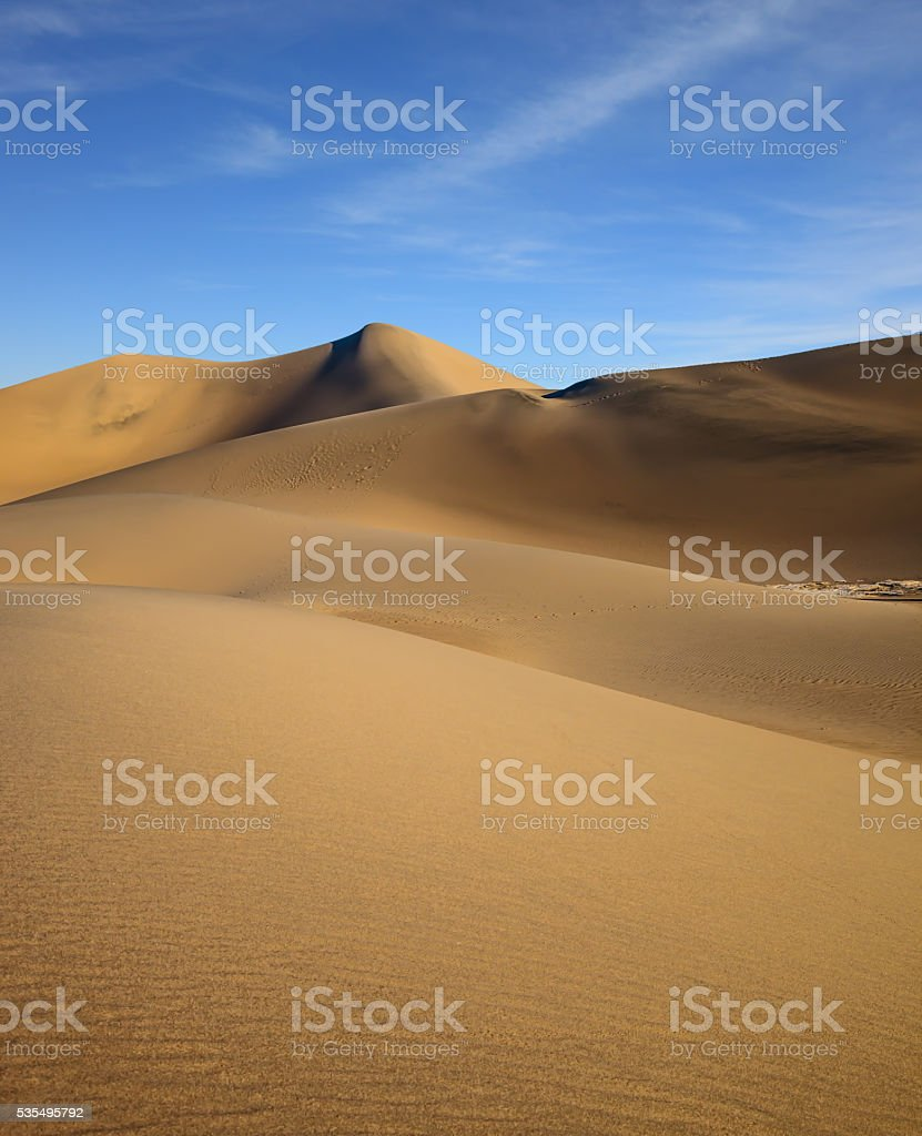 The soft curves of yellow sand dunes stock photo