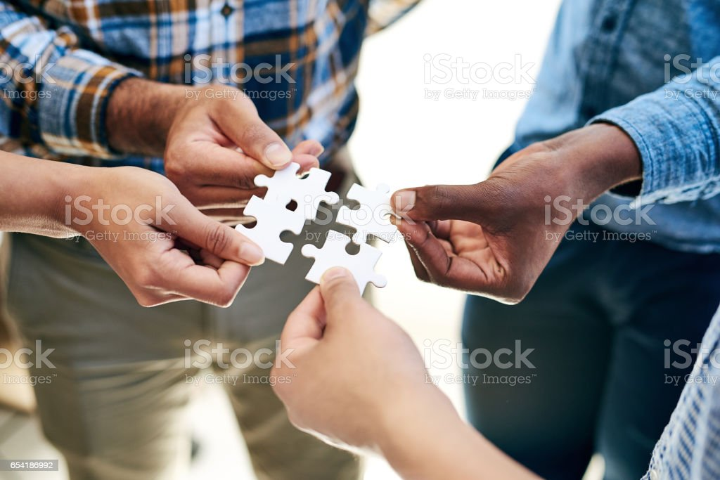The solution is in the hands of the team stock photo