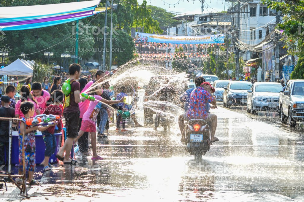Chiang Rai, Thailand - April 12, 2015 : The Songkran festival or Thai New Year`s festival. Water fights in the town. stock photo