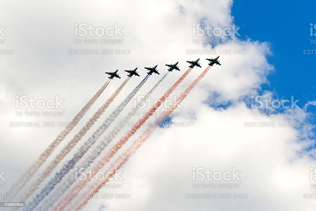 The Soviet attack aircraft Su-25 Frogfoot producedsmoke three colors stock photo