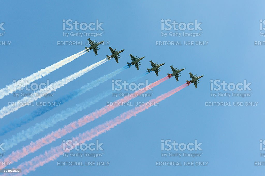 The Soviet attack aircraft Su-25 Frogfoot producedsmoke three colors stock photo