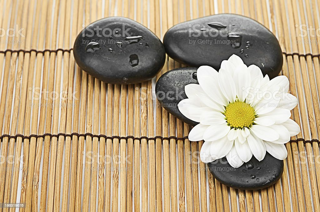The spa a stone on bamboo background royalty-free stock photo