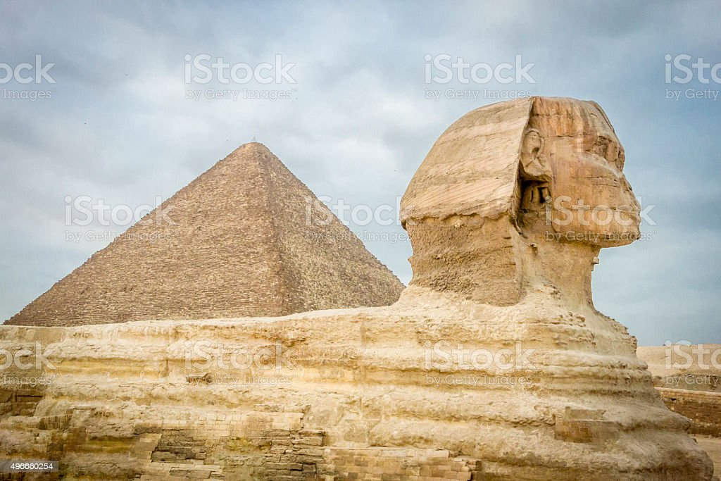 The Sphinx and Pyramid of Khufu stock photo